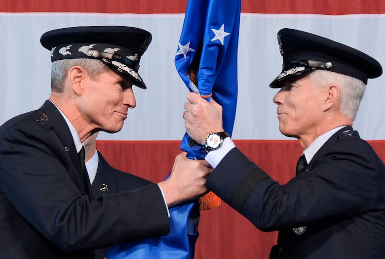 Air Force Chief of Staff Gen. Norton Schwartz (left) hands the Air Force Space Command flag to Gen. William L. Shelton (right), as General Shelton becomes the 15th commander of AFSPC in a ceremony Jan. 5, 2011, at Peterson Air Force Base, Colo. (U.S. Air Force photo/Duncan Wood)