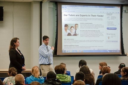 Middle school students from Randolph Independent School District learn about the free tutoring available to them through tutor.com during a presentation by the companies representatives, Ms. Kara Froman and Mr. Bart Epstein. The Department of Defense funded program is available to active duty dependents world-wide through the students school, saving parents the standard $40 to $70 an hour fee for tutoring.(U.S. Air Force photo/Steve Thurow)