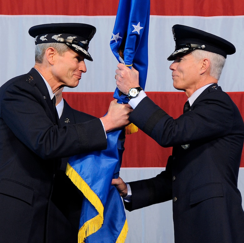 Air Force Chief of Staff Gen. Norton Schwartz (left) hands the Air Force Space Command flag to Gen. William Shelton (right) as he becomes the 15th commander of AFSPC in a ceremony Jan. 5 at Peterson Air Force Base, Colo. (U.S. Air Force photo by Duncan Wood)