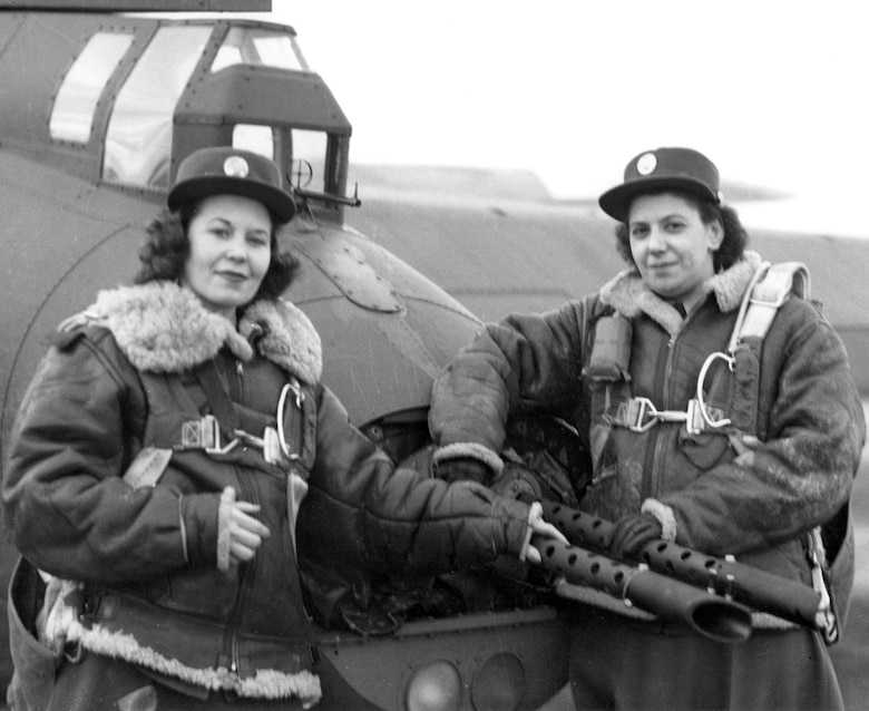 WACs pose by the tail guns of a 401st BG B-17 at an 8th Air Force base in England in January 1944.