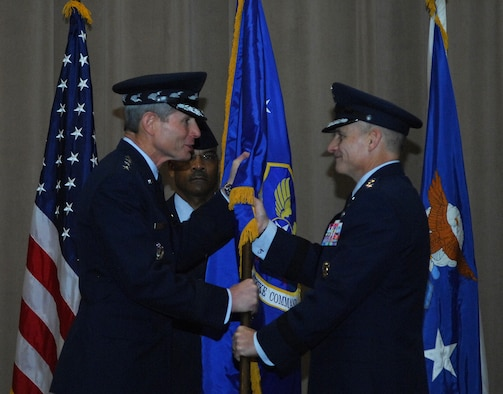 BARKSDALE AIR FORCE BASE, La. -- Air Force Chief of Staff Gen. Norton Schwartz passes the Air Force Global Strike Command guidon to Lt. Gen. Jim Kowalski as he assumes command Jan. 6, becoming responsible for organizing, training and equipping all U.S. ICBMs and nuclear-capable bombers.  Command Chief Master Sgt. Jack Johnson serves in his role as guidon bearer.  (U.S. Air Force photo/Master Sgt. Corey Clements)
