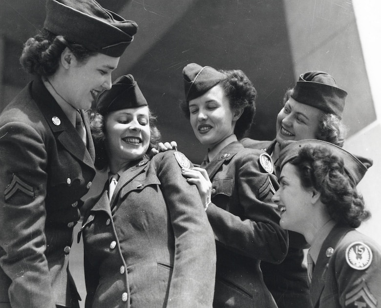 Air WACs in WWII with new 15th AF shoulder sleeve insignia.