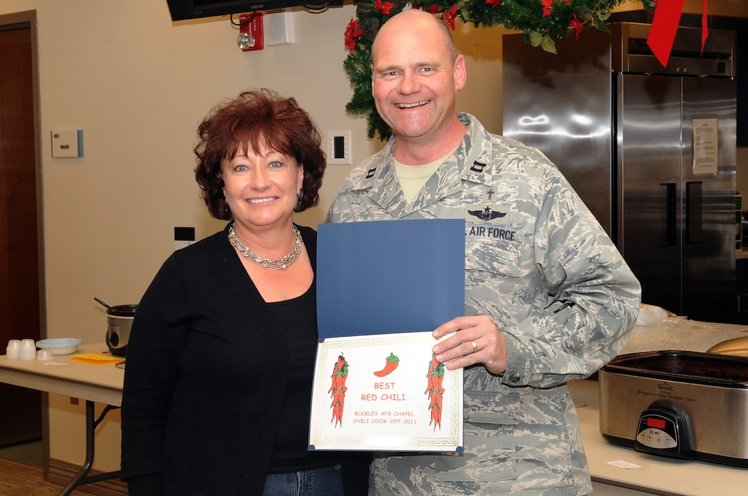 BUCKLEY AIR FORCE BASE, Colo.-- Cindy Zulli wins an award during the annual chili cook-off at the chapel, Jan. 5, 2011. Mrs. Zulli won in the Best Red Chili category of the competition. (U.S. Air Force photo by Airman Manisha Vasquez)