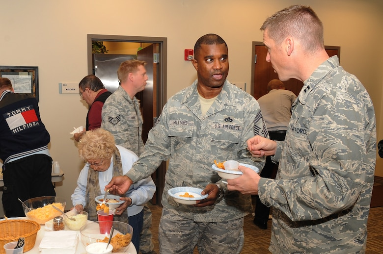 BUCKLEY AIR FORCE BASE, Colo.-- Team Buckley members gather at the eighth annual Chili Cook-off at the base chapel, Jan. 5, 2011. Members sampled great chili, mingled with one another and got to vote on their favorite chili at the end of the event. (U.S. Air Force photo by Airman Manisha Vasquez)