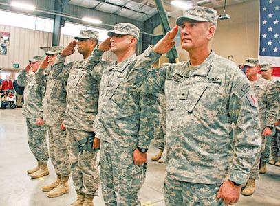 Leaders of the 1st Inf. Div. salute during the playing of the national anthem Jan. 3 at a DHHB redeployment ceremony.
