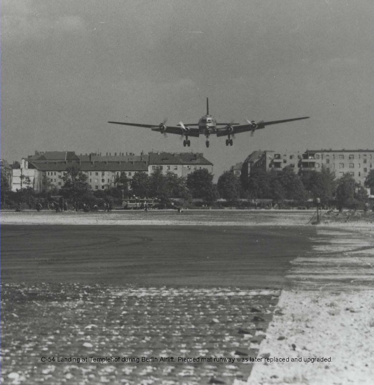 C-54 Landing at Templehof during Berlin Airlift.  Pierced steel runway matting could not stand up to the heavy usage and an improved runway had to be built.
