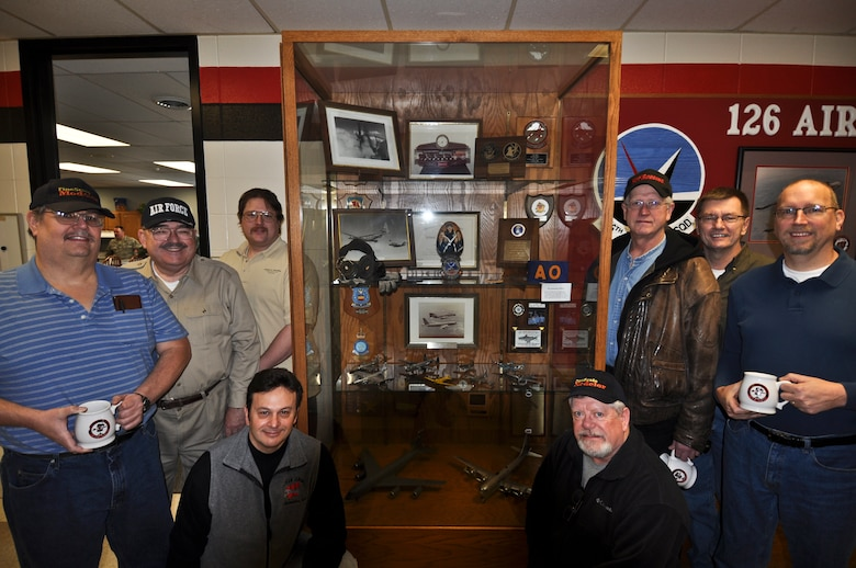 Members of the Richard I. Bong chapter of the International Plastic Model Society gather near the display case in the Operations Squadron building of the 128th Air Refueling Wing, Milwaukee, Wis., on Saturday, January 8, 2011.  The local IPMS chapter donated 11 model aircraft to the 128 ARW, all of which are replicas of aircraft flown throughout the Wing's history.  U.S. Air Force photo by Staff Sgt. Jeremy Wilson / Released