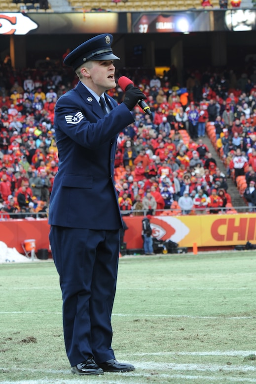 KANSAS CITY, Mo. - Staff Sgt. Nathan Tawbush, 19th Munitions Squadron weapons maintenance team chief, sings 'God Bless America' during the half-time show of the Kansas City Chiefs' Wild Card game against the Ravens Jan 9. The Ravens beat the Chiefs 30-7, advancing to the next round. (U.S. Air Force photo by Senior Airman Carlin Leslie)