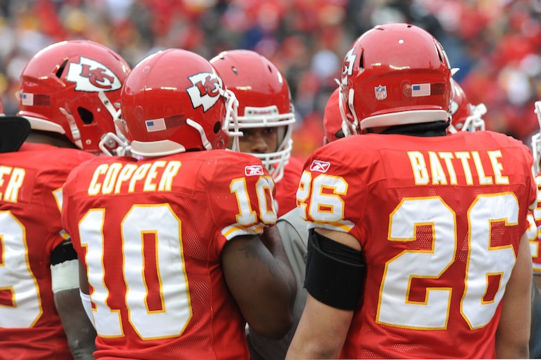 KANSAS CITY, Mo. - Members of the Kansas City Chiefs team huddle with their coordinator, during a National Football League Wild Card game Jan 9. The Chiefs lost to the Baltimore Ravens 30-7. (U.S. Air Force photo by Senior Airman Carlin Leslie)