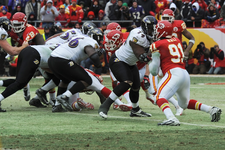 KANSAS CITY, Mo. - Michael Oher, a tight end for the Baltimore Ravens blocks Tamba Hali, a linebacker for the Kansas City Chiefs, during the opening round of the National Football League play-offs Jan 9. (U.S. Air Force photo by Senior Airman Carlin Leslie)