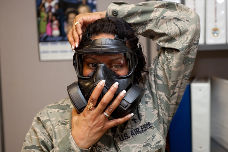 Chaplin (Major) Myrtle Bowen insures there is a good seal of her mask during a gas mask fit test. The D.C.  Air National Guard is replacing all MCU-2 A/P gas masks with the new M50 gas mask. The new M50 gas mask has twin conformal filters, which allow 50 percent improvement in breathing resistance, and allows for over 24 hours of protection against chemical or biological agents and radioactive particulate matter. (U.S. Air Force Photo by Tech Sgt. Gareth Buckland)