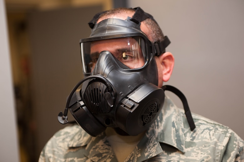 A1C Joel Cruzmarcano prepares to take a gas mask fit test. The D.C.  Air National Guard is replacing all MCU-2 A/P gas masks with the new M50 gas mask. The new M50 gas mask has twin conformal filters, which allow 50 percent improvement in breathing resistance, and allows for over 24 hours of protection against chemical or biological agents and radioactive particulate matter. (U.S. Air Force Photo by Tech Sgt. Gareth Buckland)