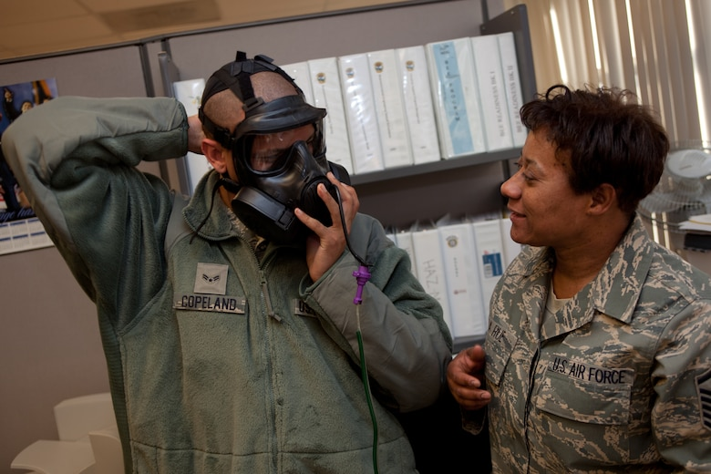 MSgt. Ollie La Rue inspects A1C Carl Copeland's gas mask during a gas mask fit test. The D.C. Air National Guard is replacing all MCU-2 A/P gas masks with the new M50 gas mask. The new M50 gas mask has twin conformal filters, which allow 50 percent improvement in breathing resistance, and allows for over 24 hours of protection against chemical or biological agents and radioactive particulate matter. (U.S. Air Force Photo by Tech Sgt. Gareth Buckland)