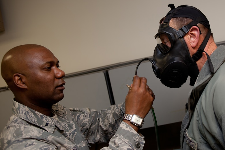 Lt. Andre Slaughter inspects TSgt Robert Wise's gas mask during a gas mask fit test. The D.C. Air National Guard is replacing all MCU-2 A/P gas masks with the new M50 gas mask. The new M50 gas mask has twin conformal filters, which allow 50 percent improvement in breathing resistance, and allows for over 24 hours of protection against chemical or biological agents and radioactive particulate matter. (U.S. Air Force Photo by Tech Sgt. Gareth Buckland)