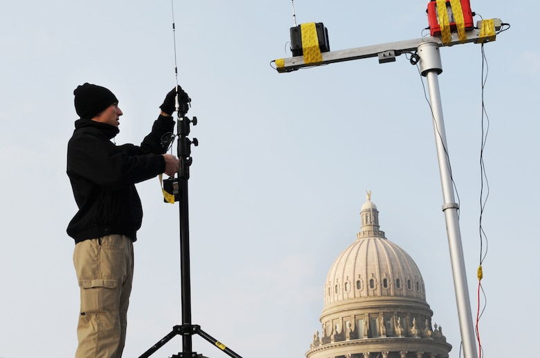Master Sgt. Aaron Decker from the 101st Weapon of Mass Destruction Civil Support Team places the receiving air monitor equipment communicating a signal from within the Capital to continually monitoring for Hazardous environments during the Inaugural Ball on Saturday, January 8th.