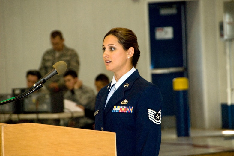 Tech. Sgt. Chandra Smith sing's 'Amazing Grace' at the 162nd Fighter Wing's assumption of command ceremony in honor of the victims involved in the Jan. 8 shooting in Tucson, Ariz. (U.S. Air Force photo/Master Sgt. Dave Neve)