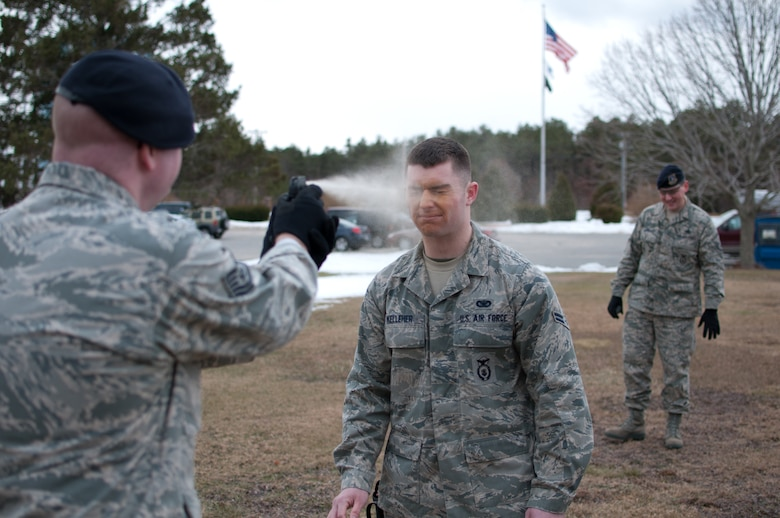 Airman 1st Class Kelleher of the 102nd Security Forces Suadron is sprayed with Cap-Stun pepper-spray as part of a security forces training event held on Otis Air National Guard Base, Mass. on January 9, 2011. Security Forces airmen were sprayed with the pepper-spray so they are familiar with it's affects and can still perform their duties if they come in contact with it.