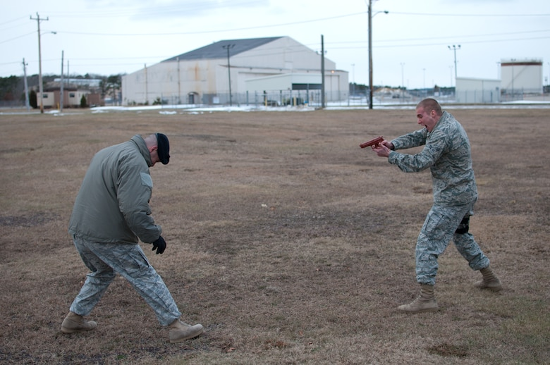 Airman 1st Class Weise of the 102nd Security Forces Suadron tries to fend off an aggressor after being sprayed with Cap-Stun pepper-spray as part of a security forces training event held on Otis Air National Guard Base, Mass. on January 9, 2011. Security Forces airmen were sprayed with the pepper-spray so they are familiar with it's affects and can still perform their duties if they come in contact with it.