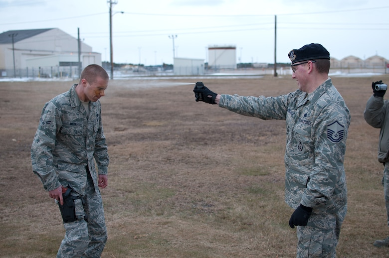 Airman 1st Class Weise of the 102nd Security Forces Suadron is sprayed with Cap-Stun pepper-spray by Master Sgt. Christopher Lafrance as part of a security forces training event held on Otis Air National Guard Base, Mass. on January 9, 2011. Security Forces airmen were sprayed with the pepper-spray so they are familiar with it's affects and can still perform their duties if they come in contact with it.