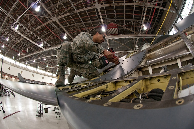 Staff. Sgt Ebon Mitchell, 113th Wing maintenance group, District of Columbia Air National Guard, attaches F-16 body panels that is currently in its 300 hour phase inspection Jan. 8, 2011 at Joint Base Andrews, Md. (U.S. Air Force photo by Master Sgt. Dennis Young)