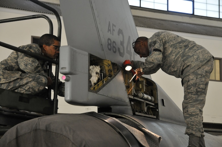 Staff. Sgt. Ebon Mitchell (left) and Staff Sgt. Michael Chapman (right) ,113th Wing Maintenance Group, District of Columbia Air National Guard, replace F-16 body panels after a 300-hour phase inspection Jan. 7, 2011 at Joint Base Andrews, Md. (U.S. Air Force photo by Tech. Sgt William R. Parks)