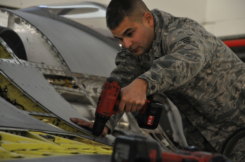 Staff Sgt. William Johnson,113th  Wing Maintenance Group, District of Columbia Air National Guard, attaches a panel during part of the phase inspection Jan.  7, 2011 at Joint Base Andrews, Md. (U.S. Air Force photo by Tech. Sgt William R. Parks)