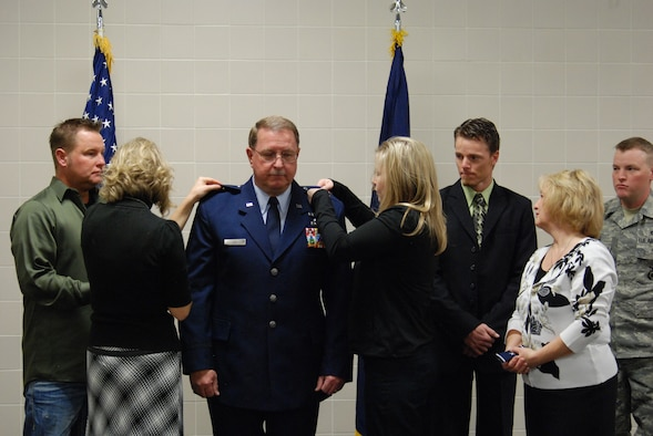 Brig. Gen. Wayne E. Lee, the Utah Assistant Adjutant General for Air, is pinned on by family members Joshua Lee, Rachel Hufstetter, Heather VanWagenen, Jade Lee, Tweet Lee and Tech. Sgt. Chester Lee during a promotion ceremony Jan. 8, 2011, at the Utah Air National Guard Base dining facility. In his comments following the pinning, General Lee mentioned he was humbled by the incredible faith and confidence bestowed upon him. He vowed the Utah ANG will continue to honorably meet its missions in the future. (USAF Photo by Capt. Wayne L. Lee)(Released).
