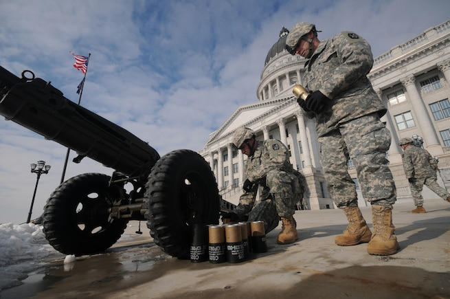 Staff Sgt. Brian Koka and Sgt. 1st Class Brent Portwood of the Utah National Guard begin to clean up their artillery piece after firing a 19-gun salute at the inauguration of Utah Gov. Gary R. Herbert on Jan. 3, 2011, at the State Capitol building in Salt Lake City.(U.S. Air Force photo by Master Sgt. Gary J. Rihn)(RELEASED)