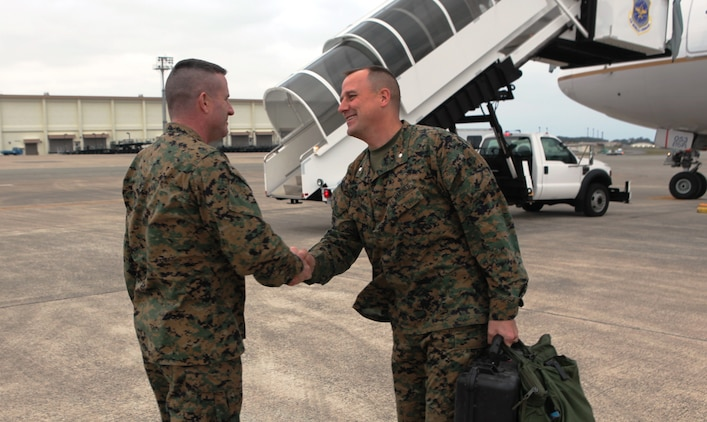 Col. Andrew MacMannis, commanding officer, 31st Marine Expeditionary Unit (left) greets Lt. Col. Pete Farnum, commanding officer, 2nd Battalion, 5th Marines, as the unit arrives from Camp Pendleton, Calif., Jan. 10. 2nd Bn., 5th Mar. is now the new Battalion Landing Team for the 31st MEU, and is scheduled to embark aboard ships of Amphibious Squadron 11 for support of Theater Security Cooperation in the Asia-Pacific region.