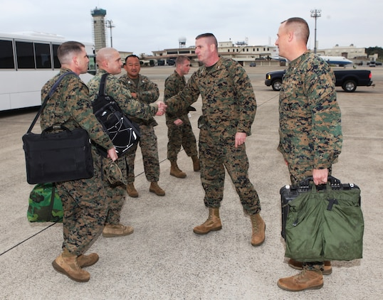 Col. Andrew MacMannis, commanding officer, 31st Marine Expeditionary Unit (center) greets senior staff of 2nd Battalion, 5th Marines, as the unit arrives from Camp Pendleton, Calif., Jan. 10. The battalion is now the new ground combat element for the 31st MEU, and is scheduled to embark aboard ships of Amphibious Squadron 11 for support of Theater Security Cooperation in the Asia-Pacific region.