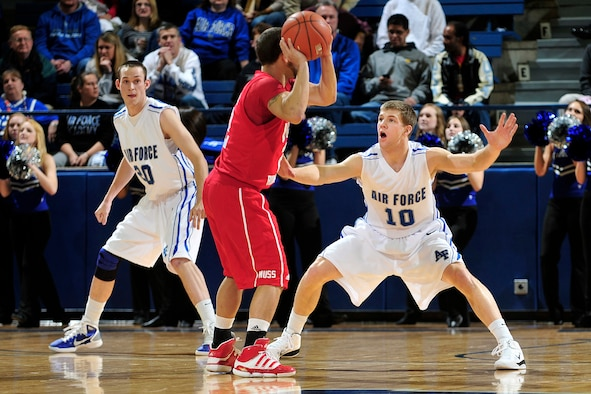 Air Force Academy sophomore Todd Fletcher plays tight defense on Utah's Chris Kupets during the Falcons Mountain West Conference home opener Jan. 5, 2011, at the Academy's Clune Arena in Colorado Springs, Colo. The Falcons upset the Utes 77-69. (Air Force photo/Bill Evans)