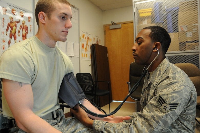 Ohio Air National Guard Senior Airman Bruce Moman, an Aerospace Medical Services Journeyman, from the 180th Fighter Wing Medical Group takes the blood pressure of a patient as part of an annual physical health assessment, January 8, 2011. Members from the 180th Medical Group are preparing for a health services inspection in April 2011.