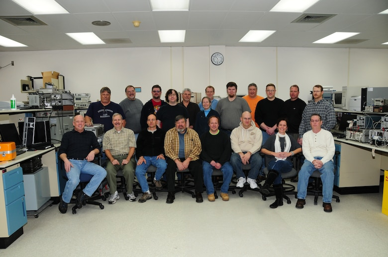 Employees of the Duluth Air National Guard Regional Precision Measurement Equipment Laboratory take time to pose for a group picture.  Please note that there are five employees missing from photo.  (U.S. Air Force photo by Master Sgt. Ralph J. Kapustka)  (Released)