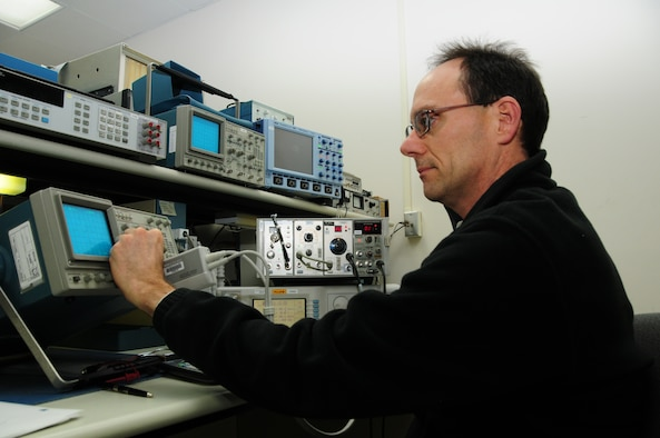 Michael Benko calibrates a digital oscilloscope while working in the Oscilloscope calibration area.  (U.S. Air Force photo by Master Sgt. Ralph J. Kapustka)  (Released)