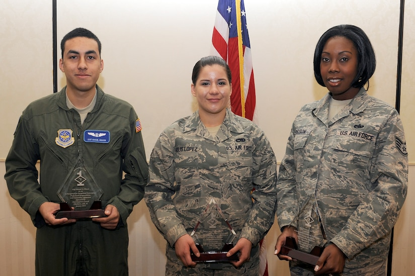 Staff Sgt. Manuel Chacon, left, Airman 1st Class Sebastiana Solis Lopez, center and SSgt Veronica Garrison were recognized as January's Diamond Sharp winners Jan. 11, 2011 at the Charleston Club. Airmen are chosen by their respective First Sergeants and recognized during an official ceremony on the first Tuesday of every month. Sergeant Chacon is with the 15th Airlift Squadron, Airman Solis Lopez is with the 437th Aircraft Maintenance Squadron and Sergeant Garrison is with the 437th Aerial Port Squadron. (U.S. Air Force photo/Staff Sgt. Marie Brown)