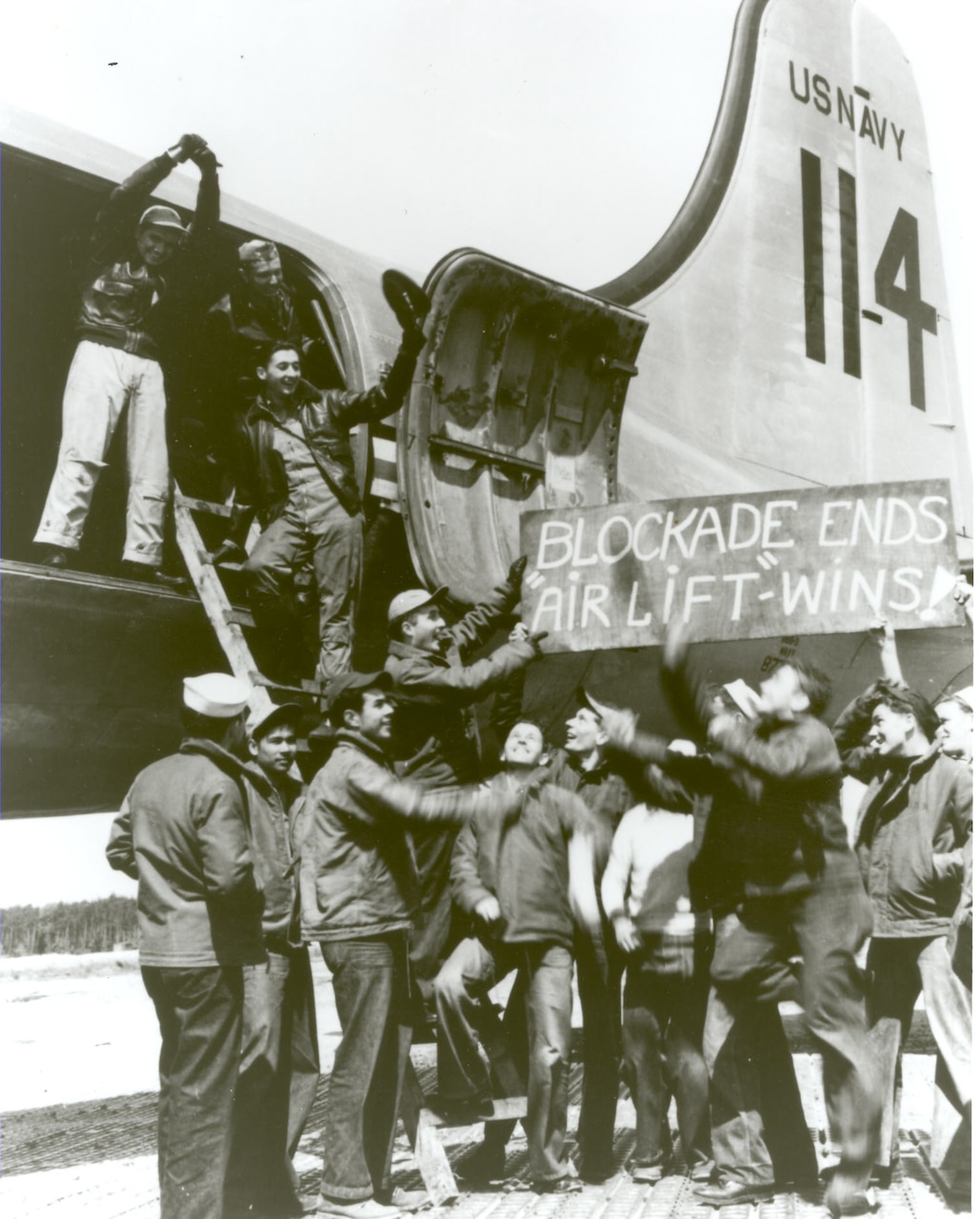 """Blockade Ends"" Air and ground crews of the US Navy Squadron VR-6 at Rhein-Main celebrate the end of the Berlin Airlift, 12 May 1949."