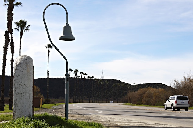 Along Camp Pendleton's Vandegrift Boulevard stands one of California's many historic El Camino Real bells that has been around long before any Marine or sailor occupied the land. The bell symbolizes the trail used by the Franciscan Padres on the journey to Northern California from Mexico in the 1800s.  The Padres were Catholic priests sent by the King of Spain to convert Native Americans of California to Catholicism, in order to become citizens of Spain. The bell on base stands where the trail crosses Vandegrift Boulevard, just inland of the main gate.