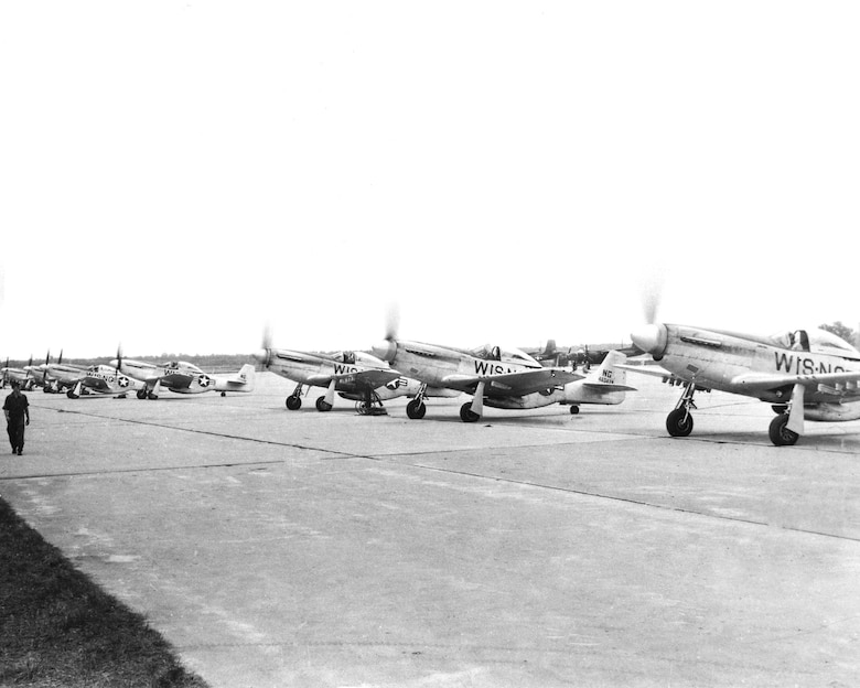 "P-51D ""Mustangs"" warm up on the flight line. The Mustang was flown from 1947-1949 and from 1952-1953."