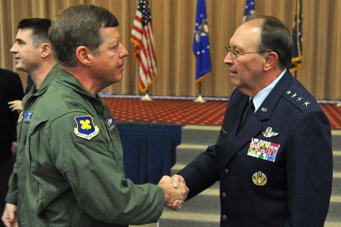 Lt. Gen. Charles E. Stenner Jr., commander of the Air Force Reserve Command, speaks with Col. Keith Schultz, commander, 307th Operations Group, after reactivation ceremonies for the 307th Bomb Wing at Barksdale Air Force Base, La., Jan. 8, 2011. Colonel Schultz is wearing the new 307th BW patch on his shoulder. As for the historic meaning of the original design, ultramarine blue is the color of the Air Forces. The four petals of the dog wood stands for the four combat squadrons of the group with the stem representing the headquarters binding the four groups together. During the same ceremonies, the 917th Operations Group was re-designated as the 917th Fighter Group and the 917th Wing was deactivated. (U.S. Air Force photo/Staff Sgt. Travis Robertson)