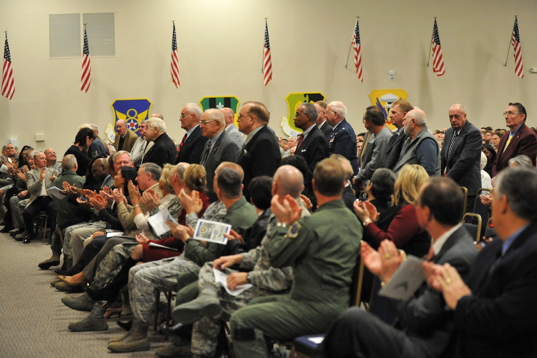 Approximately 40 307th Bomb Wing alumni from World War II, the Korean War, Vietnam and the Cold War era are recognized during reactivation ceremonies for the 307th Bomb Wing in Hoban Hall at Barksdale Air Force Base, La., Jan. 8, 2011. During the same ceremonies, the 917th Operations Group was re-designated as the 917th Fighter Group and the 917th Wing was deactivated. (U.S. Air Force photo/Staff Sgt. Travis Robertson)
