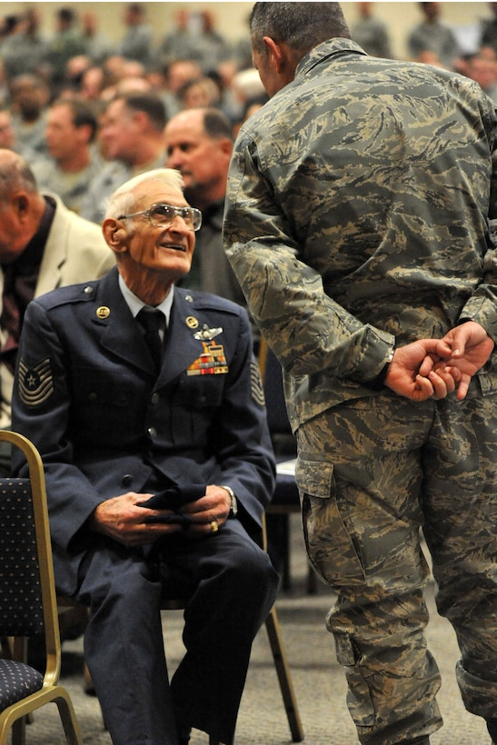 A present day 307th Bomb Wing Airman speaks with Master Sgt. (Ret) Loren T. Longman, a 307th BW alumni before the reactivation ceremonies for the 307th BW at Barksdale Air Force Base, La., Jan. 8, 2011. Sergeant Longman is a World War II and Korean War veteran who served in the 307th BW from 1947-55. During the same ceremonies, the 917th Wing was deactivated and the 917th Operations Group was re-designated as the 917th Fighter Group. (U.S. Air Force photo/Staff Sgt. Travis Robertson)