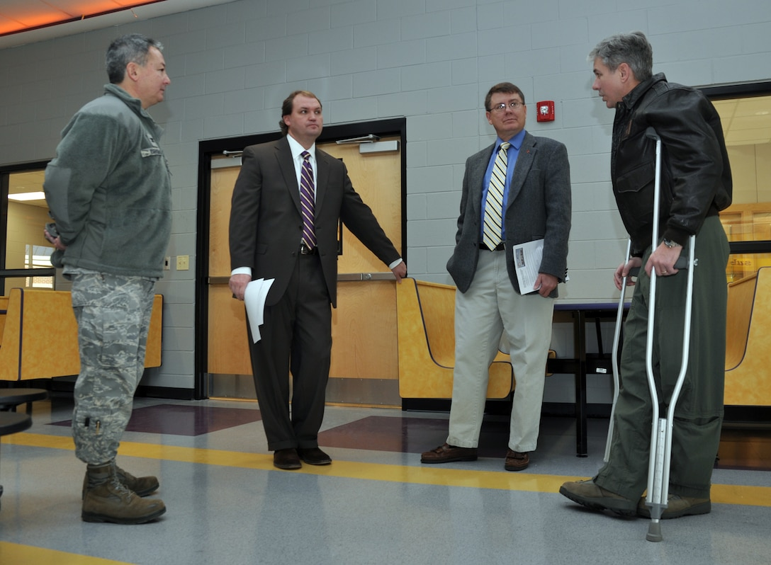 Col. Barre Seguin, 14th FTW commander, speaks with Dr. Del Phillips, Columbus Municipal School District Superintendent, Col. Ken Bryson, 14th MSG commander, and E.J. Griffis, 14th FTW school liaison officer, Jan. 13 inside the cafeteria of the newly constructed Columbus Middle School on Highway 373 outside Columbus AFB. The new school will begin housing students Jan. 19 and is estimated to have just over 1,000 students attending it this year. (U.S. Air Force photo/Staff Sgt. Jacob Corbin).