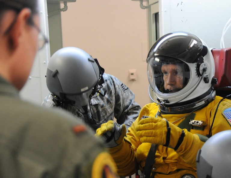 Gen. William M. Fraser III, commander of Air Combat Command, gets strapped into the high-altitude chamber at Beale Air Force Base, Calif., Jan. 10 for a decompression test. The chamber session familiarized the general with the pressure suit and flying at high altitudes. (U.S. Air Force photo/9th Reconnaissance Wing Public Affairs)