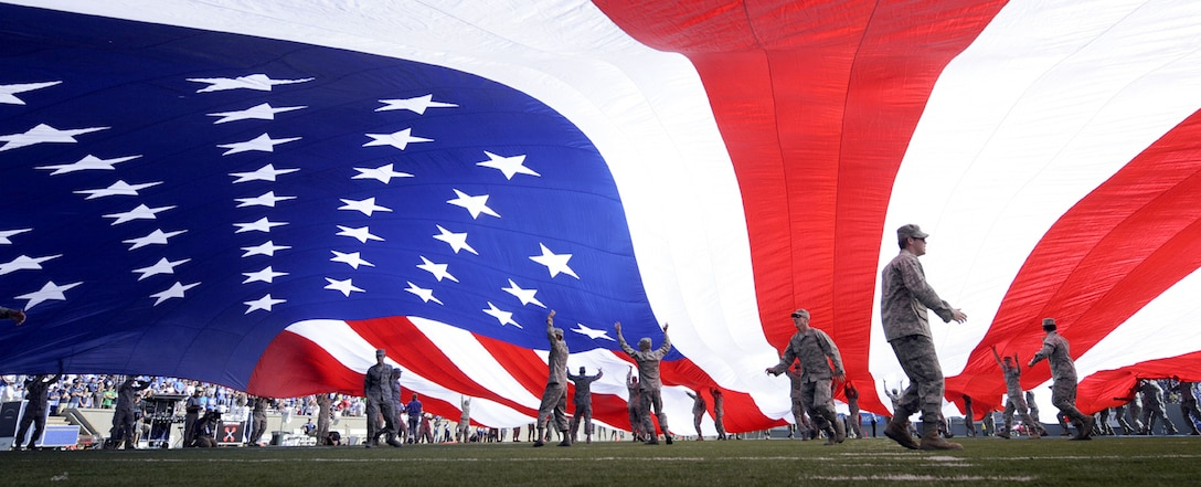 Air Force Academy cadets keep a giant American flag aloft during the Air Force-Brigham Young University halftime 9/11 memorial ceremony at Falcon Stadium near Colorado Springs, Colo., Sept. 11, 2010. The flag measured about 55 yards by 30 yards. (U.S. Air Force photo/Dennis Rogers)