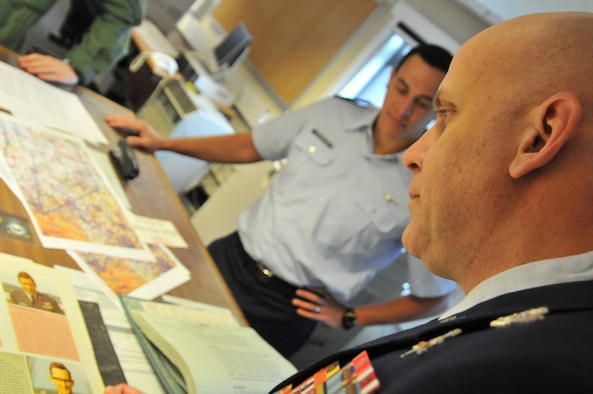 ROYAL AIR FORCE COTTESMORE, England -- Master Sgt. Louis Distelzweig, a pararescueman with the 56th Rescue Squadron at RAF Lakenheath, looks at a picture of his father, Capt. Louis Distelzweig Jr., in an album at the Royal Air Force's No. 1 Squadron, Jan. 11. Sergeant Distelzweig visited RAF Cottesmore to view the Harrier aircraft his father flew in the 1970 as an exchange pilot. (U.S. Air Force photo/Senior Airman David Dobrydney)