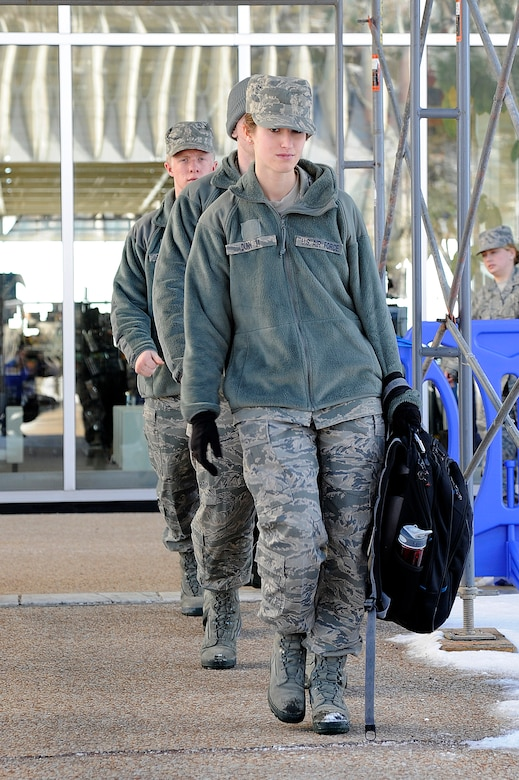 Cadet 4th Class Cassandra Dunn and two other cadets walk along a covered walkway near the McDermott Library at the Air Force Academy Jan. 12, 2011. A $4.3-million construction project to repair the roof of the library and other sections of Fairchild Hall is estimated to be finished in October. Ongoing construction at the Academy is valued at $143.3 million. (U.S. Air Force photo/Mike Kaplan)