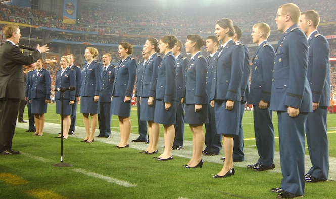 The Cadet Chorale sings the national anthem at the BCS national championship game in Phoenix Jan. 10, 2010. Other prominent Cadet Chorale appearances have included the 2006 Rose Bowl Game, Super Bowl XXIX (2005) in Jacksonville, Fla., and the 2005 NBA All-Star Game in Denver. (U.S. Air Force photo/2nd Lt. Meredith Kirchoff)