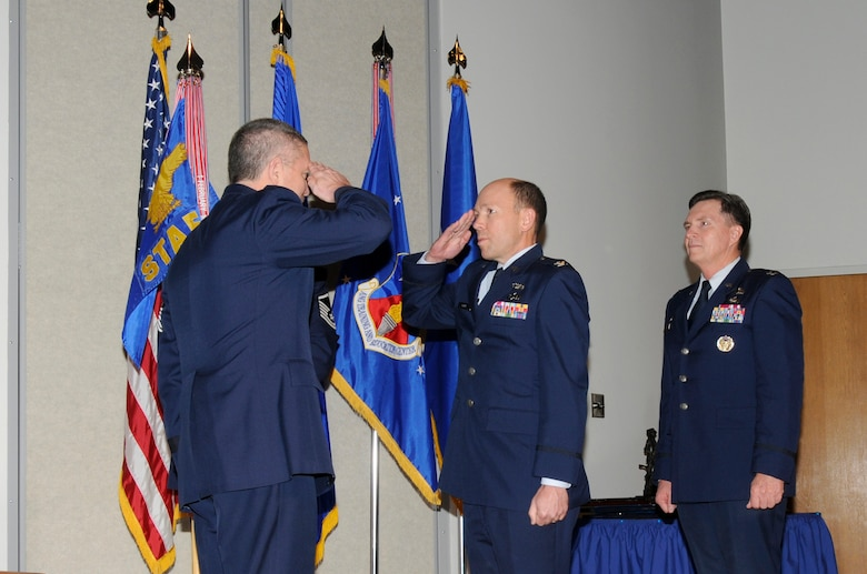 McGHEE TYSON AIR NATIONAL GUARD BASE, Tenn. - Col. Bradley N. McRee, center, accepts command of The I.G. Brown Air National Guard Training and Education Center from Maj. Gen. William H. Etter, left, the deputy director of the Air National Guard, in a ceremony held at Spruance Hall here, Jan. 14, 2011, while former commander, Col. Richard B. Howard, right, looks on.  (U.S. Air Force photo by Master Sgt. Kurt Skoglund/Released)
