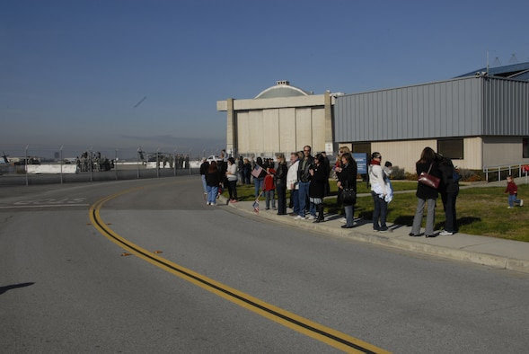 Family members and friends of deployed 129th Rescue Wing Airmen await their arrival at Moffett Federal Airfield, Calif., Jan. 12, 2011. Approximately 65 Airmen were deployed to provide combat search and rescue support for Combined Joint Task Force-Horn of Africa.  (Air National Guard photo by Tech. Sgt. Ray Aquino)