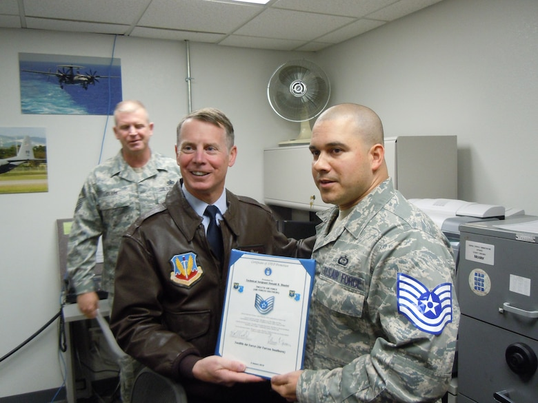 Lt. Gen. Glenn Spears, 12th Air Force (Air Forces Southern) commander bestows technical sergeant stripes to Staff Sgt. Donald Blasini Jan. 5, 2011. Now Tech. Sgt. Blasini, 612th Support Squadron, was promoted under the Stripes for Exceptional Performers program, and the promotion was a surprise for the NCO. (Courtesy photo)